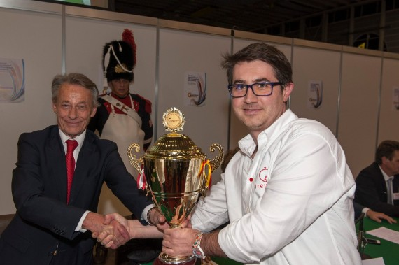 Bogdan Manoiu receiving the Grand Trophy from Jean Luc Vincent, President & Founder Geneva Invention Salon.
